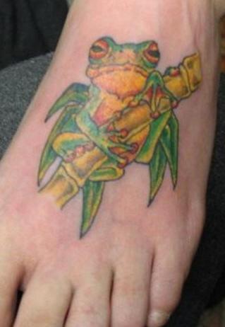 Green frog on bamboo tattoo