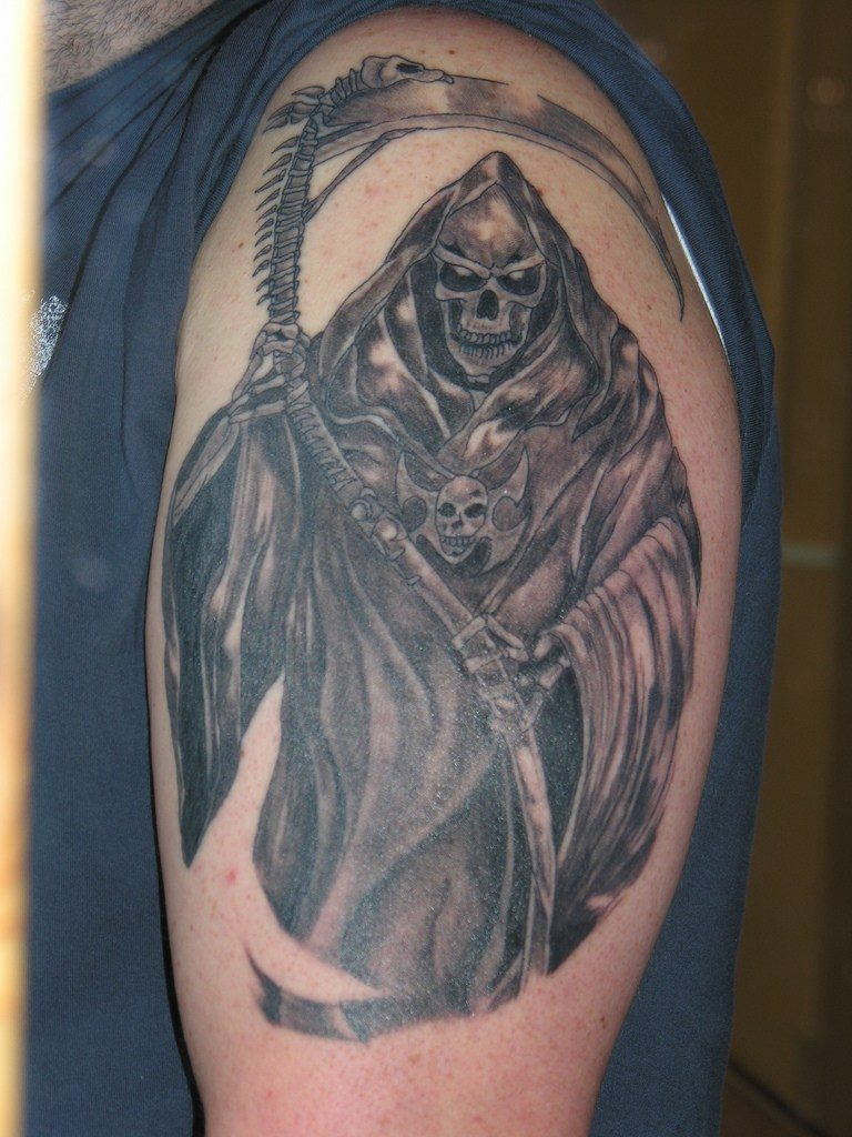 Grim reaper tattoo on shoulder