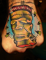 Robot, moody, green, decorated head hand tattoo