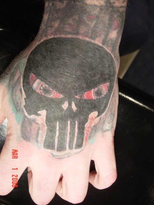 Black,conceived, dreadful,suspicious mask  hand tattoo