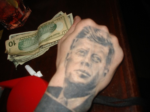 Black portrait of famous person hand tattoo