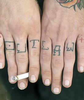 Outlaw, styled accurate inscription hand tattoo