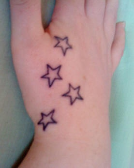 Four colorless similar stars hand tattoo
