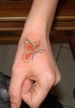 Red pretty little butterfly hand tattoo