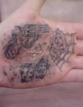 Gun, devil&quots books,skull hand tattoo