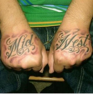 Midwest, parted curled inscription hand tattoo