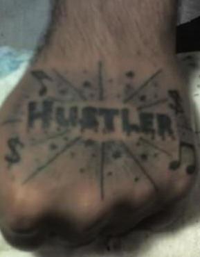 Hustler shining inscription,melodies  hand tattoo
