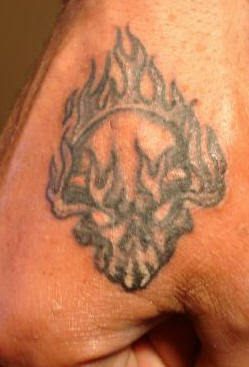 Colorless waving intensive fire  burning hand tattoo