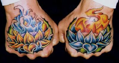Colourful  lilies with fire & water hand tattoo