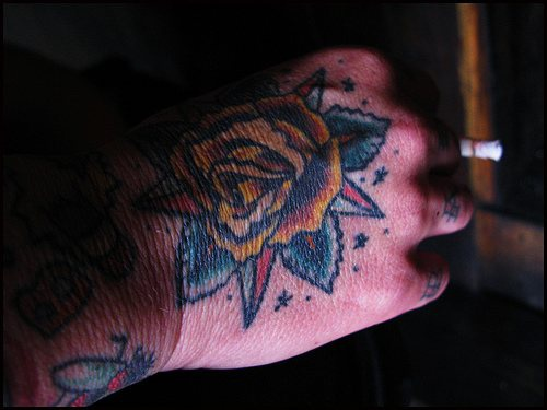 Yellow rose with beautiful leaves hand tattoo