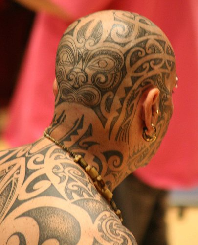 Head tattoo, rich, filled with curled stripes pattern