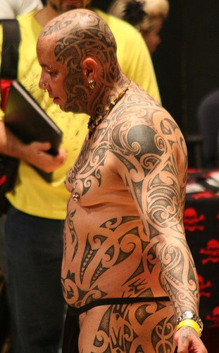 Head tattoo, black,  waving, rich  pattern
