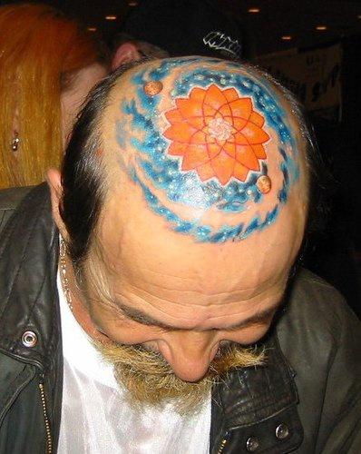 Head tattoo with designed polygonal sun, space