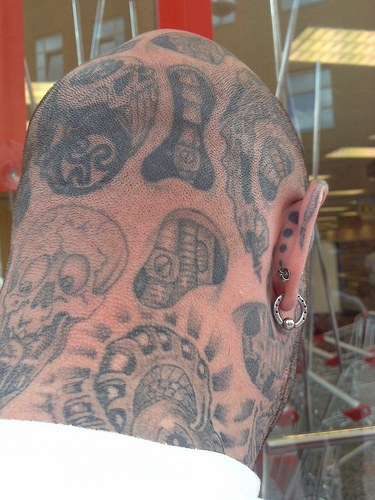 Head tattoo, monsters, different strange objects