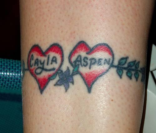 Lover names heart armband tattoo
