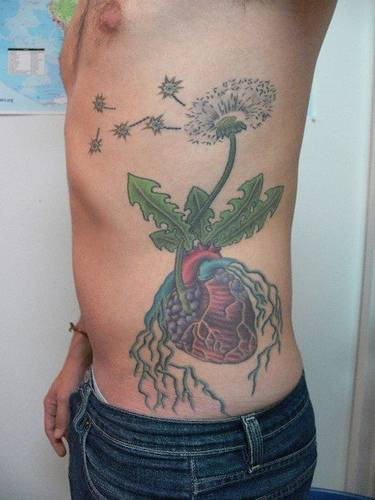 Realistic heart with dandelion in colour