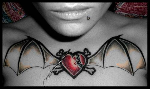 Broken heart with bat wings on chest - Tattooimages.biz
