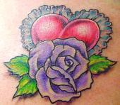 Tracery heart with purple rose tattoo