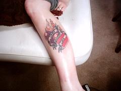 Two flaming hearts leg tattoo