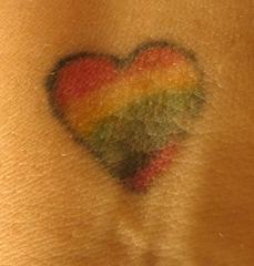 Colourful fag heart symbol tattoo
