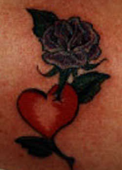 Purple flower with red heart tattoo