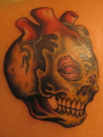 Amazing heart shaped skull tattoo