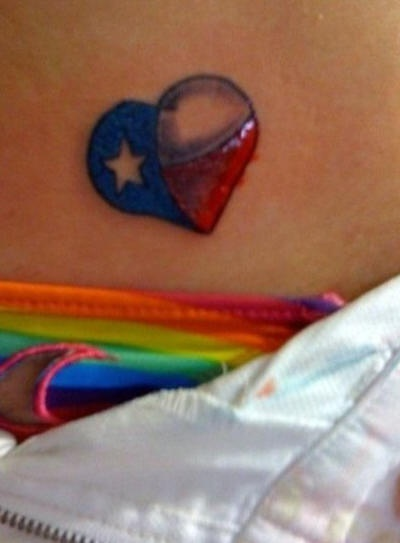 Heart with flag texture tattoo