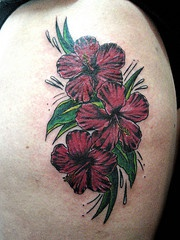 Dark violet hibiscus flowers tattoo
