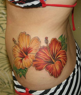 Two hibiscus flowers tattoo