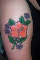 Orange hibiscus with purple flowers tattoo