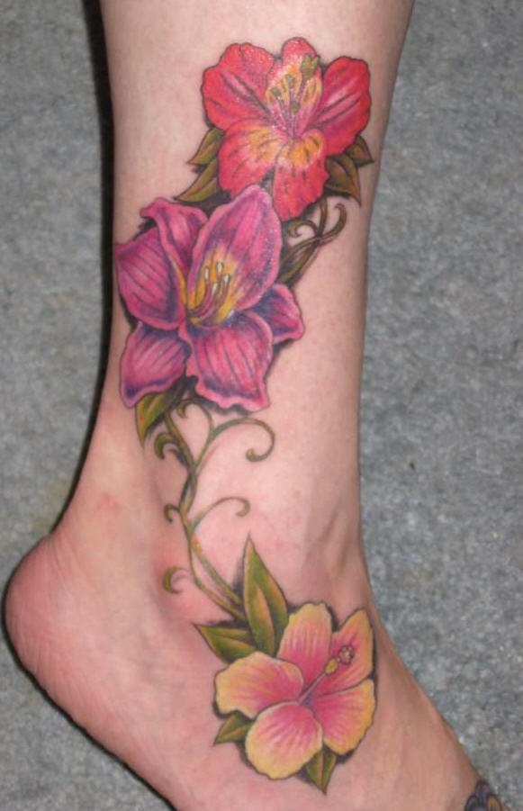 Flowers of hibiscus on leg in colour