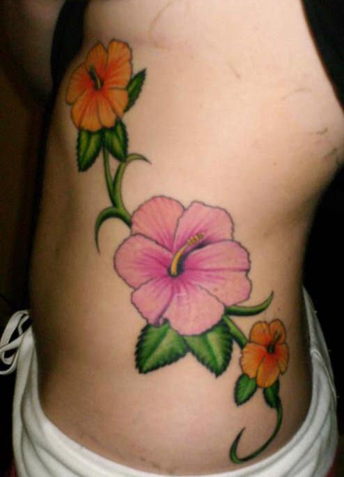 Hibiscus flowers tattoo on side