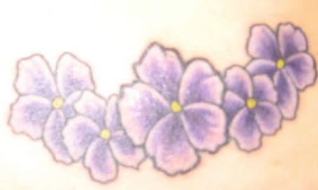 Purple flowers of hibiscus tattoo