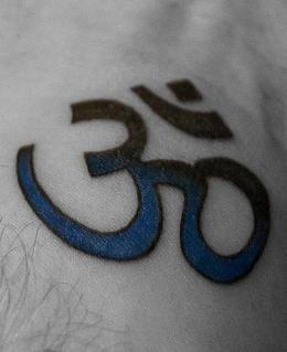 Blue and black om symbol tattoo