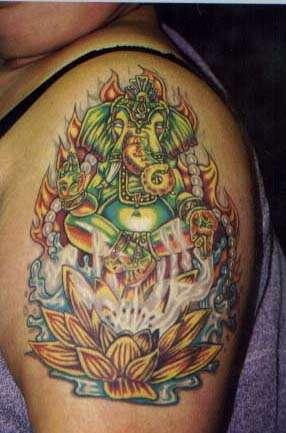 Green flaming ganesha on lotus tattoo
