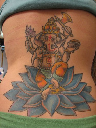 Ganesha dancing on blue lotus tattoo