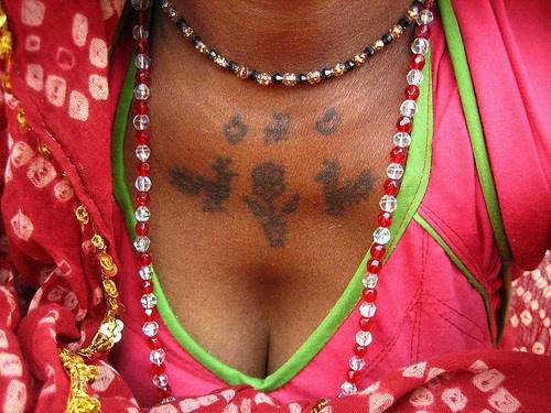 Hindu writings tattoo on chest