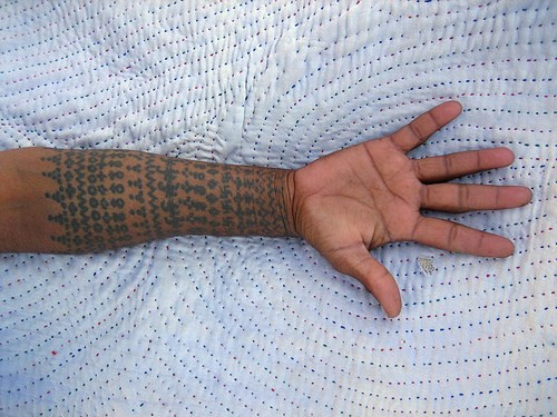 Hindu pattern sleeve tattoo