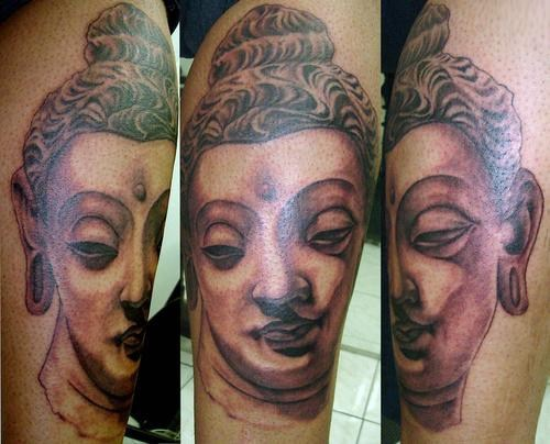 Stoned buddha face tattoo