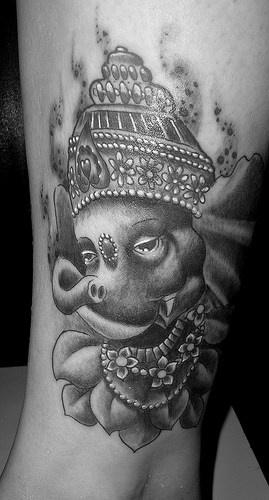 Sleepy ganesha face tattoo