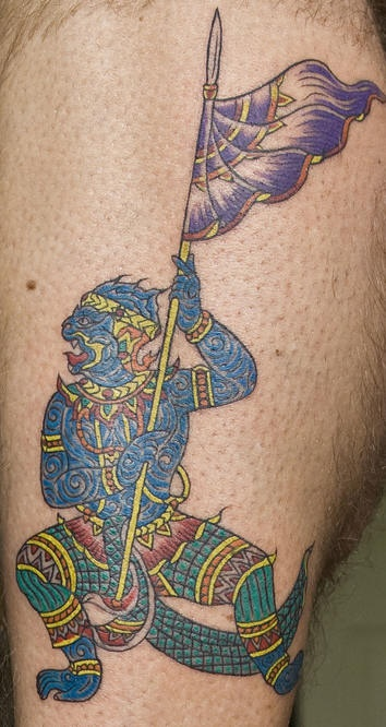 Colorful hindu warrior tattoo with spear