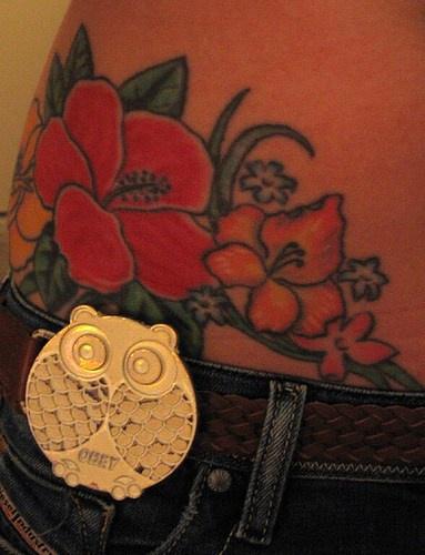 Big, parti-coloured flowers & tiny, grass hip tattoo
