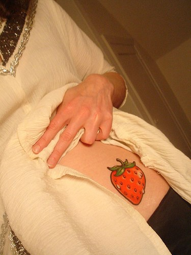 Juicy red, picturesque  strawberry hip tattoo