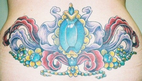 Picturesque, parti-coloured decorated gemstone hip tattoo