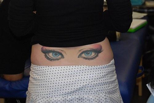 Make-up, beautiful eyes hip tattoo