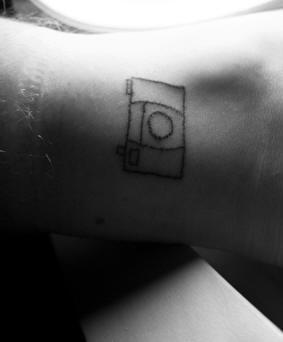 Homemade photo camera  tattoo