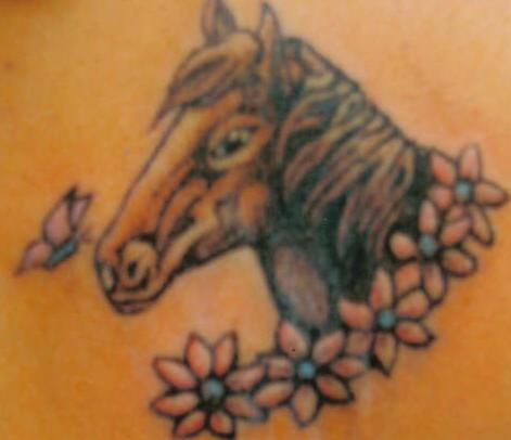 Horse head in flowers tattoo