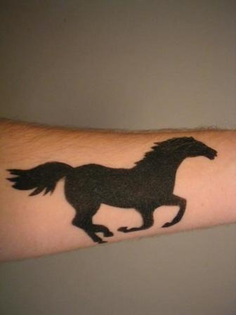 Running mustang silhouette tattoo