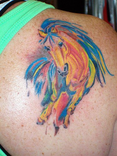 Colourful waterpaint horse tattoo