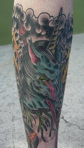 Evil zombie unicorn in storm on leg